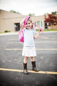 little girl with backpack at school