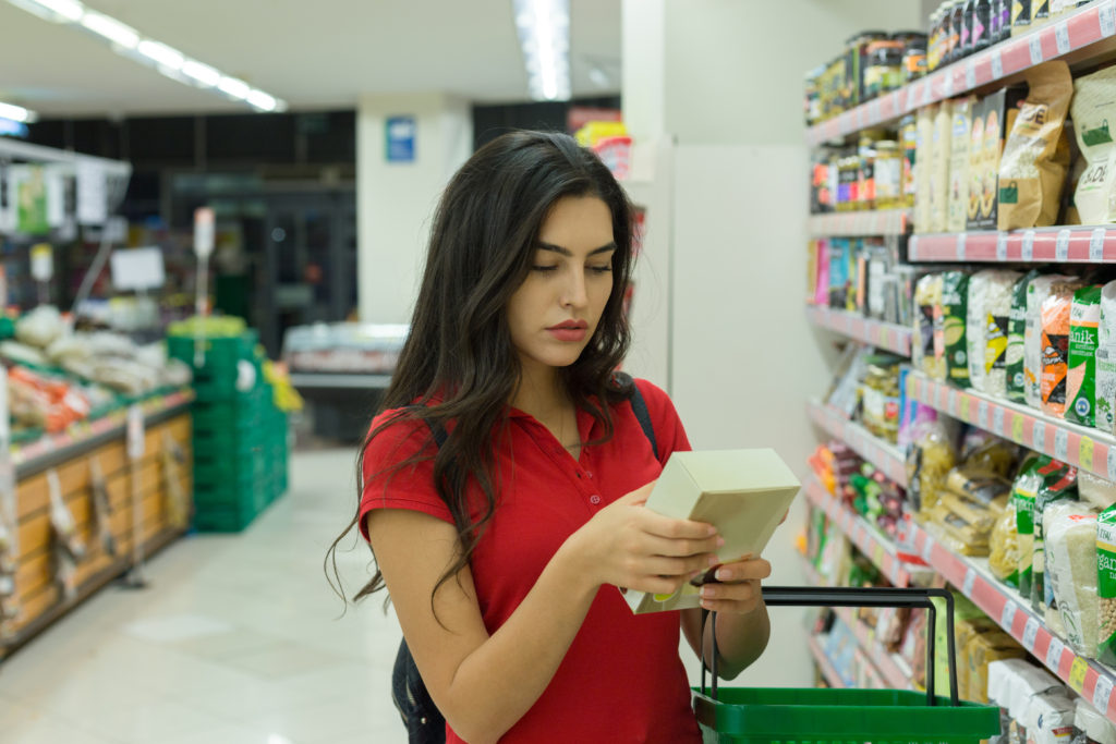 Young woman reading food labels